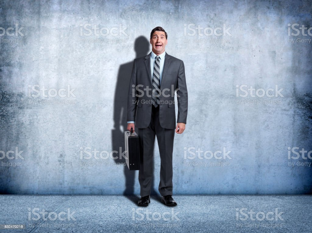 Businessman With Look Of Fear On His Face stock photo