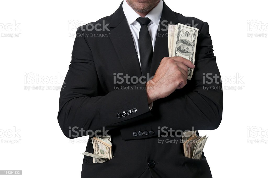 businessman with lots of dollars stock photo