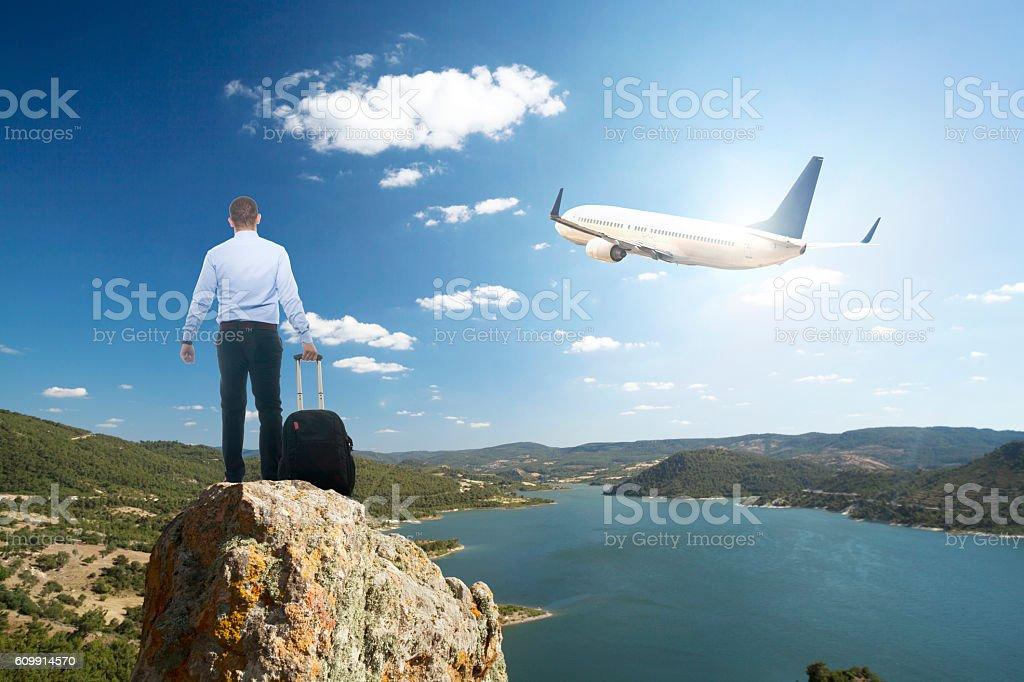 Businessman with luggage waiting on peak stock photo