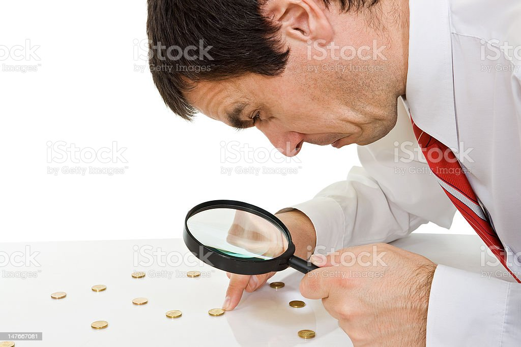 Businessman with magnifying glass royalty-free stock photo