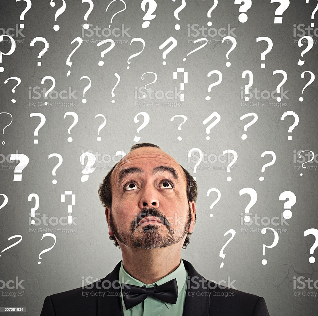businessman with many questions stock photo