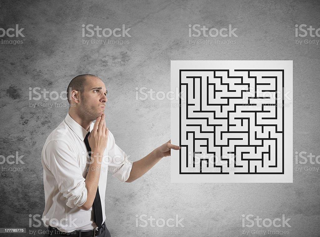Businessman with maze stock photo
