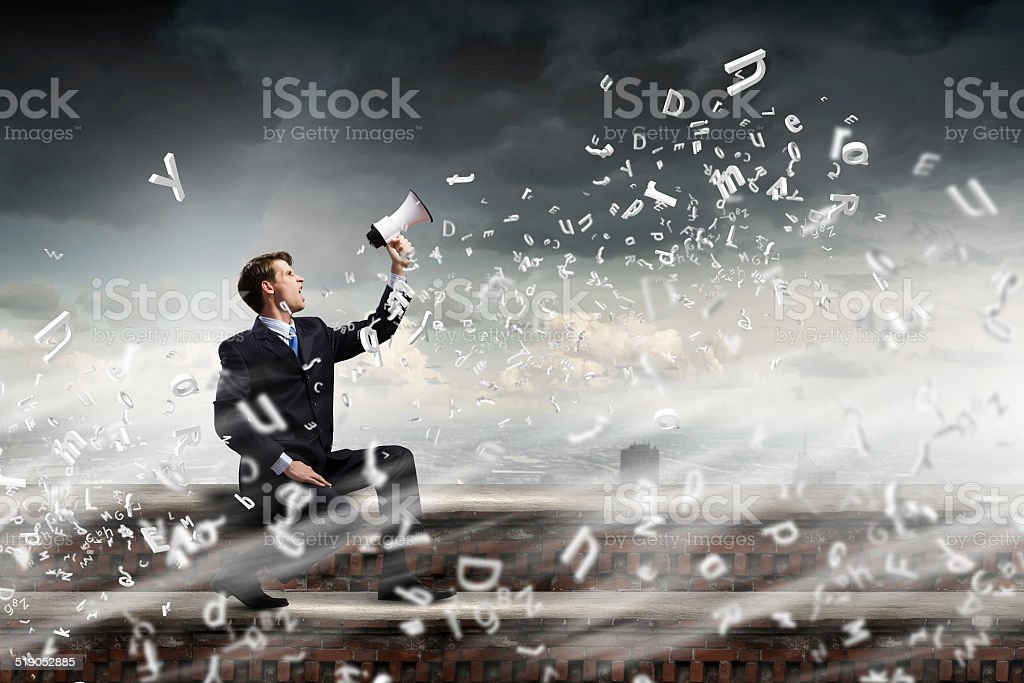 Businessman with megaphone stock photo