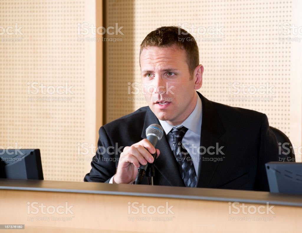 Businessman with Microphone stock photo