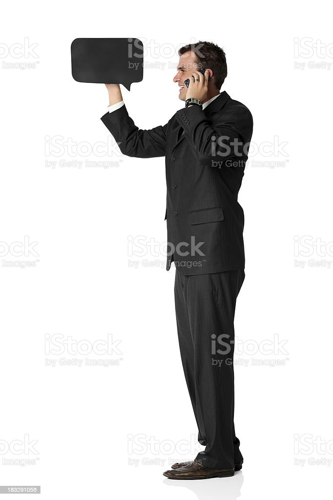 Businessman with mobile phone and speech bubble royalty-free stock photo