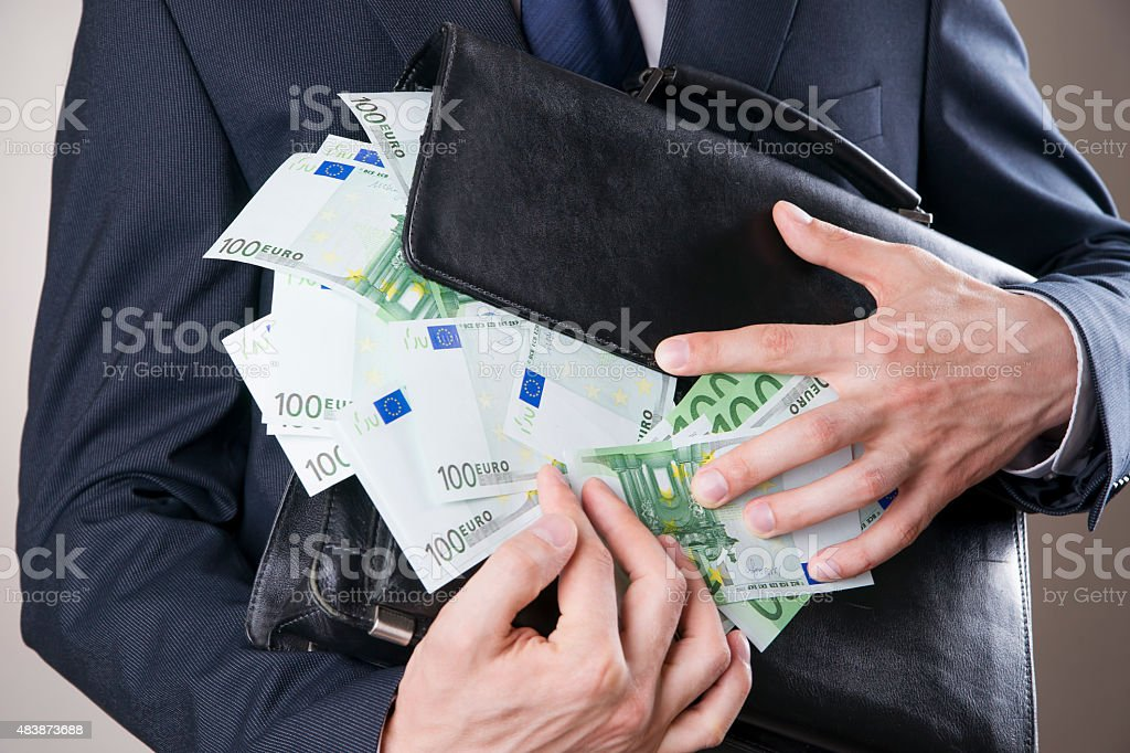 Businessman with money in studio. Corruption concept stock photo
