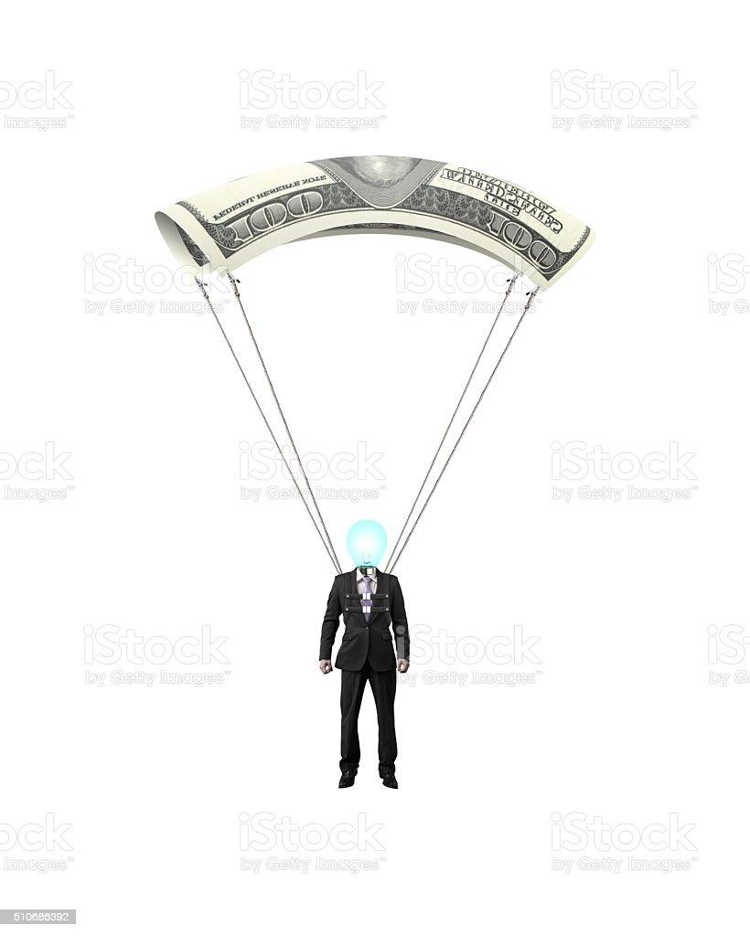 Businessman with money parachute stock photo