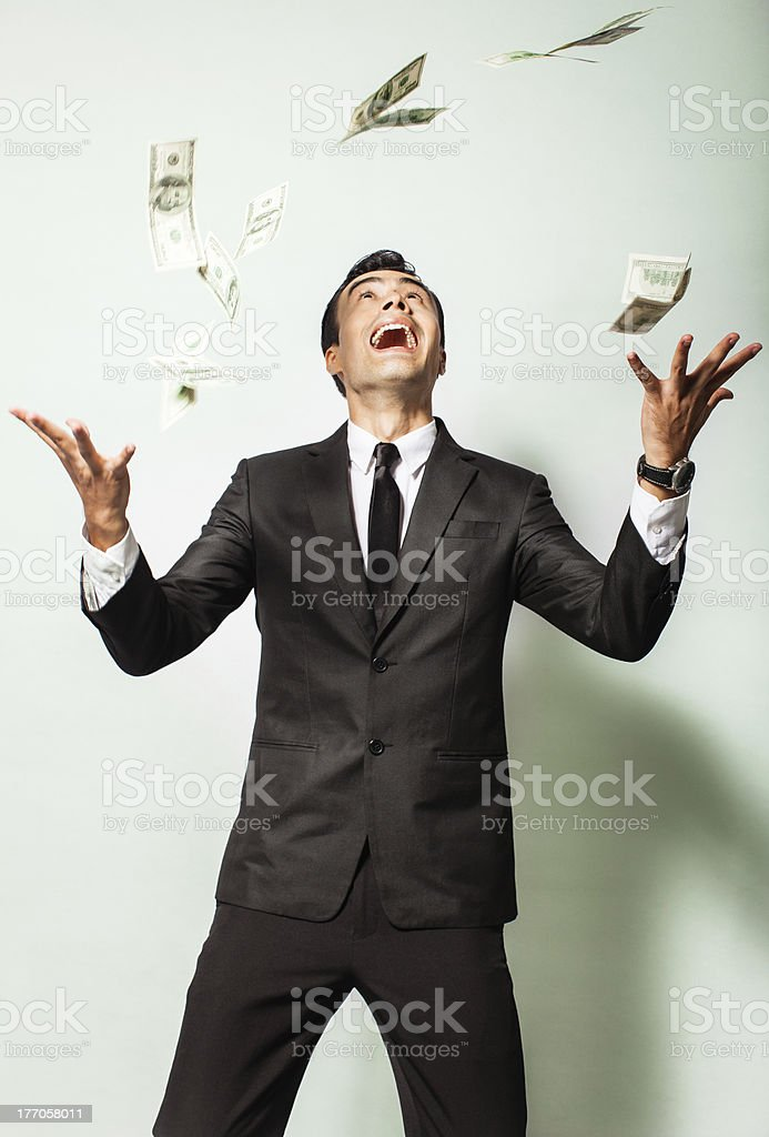 businessman with money rain royalty-free stock photo