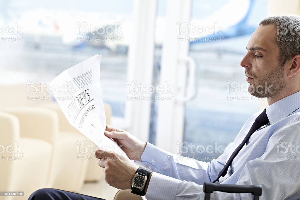 Businessman with newspaper royalty-free stock photo