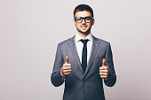 Businessman with okay gesture on white