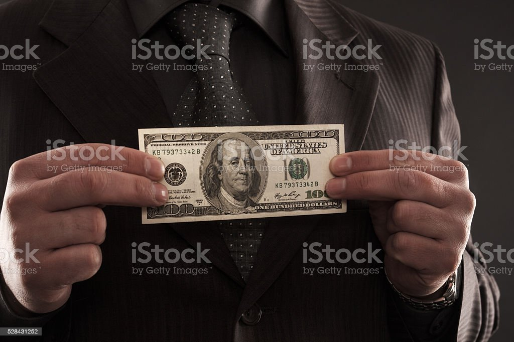 Businessman with one hundred dollars stock photo