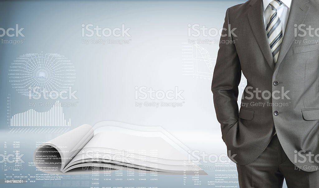 Businessman with open book stock photo