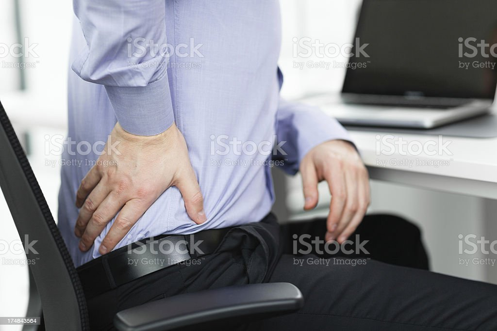 Businessman with pain in his back royalty-free stock photo