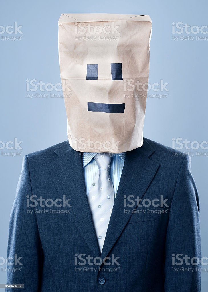 Businessman with paper bag over his head stock photo
