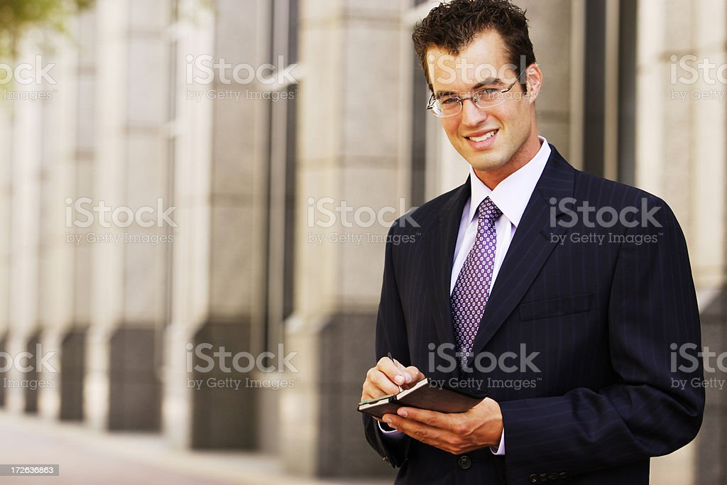Businessman with PDA stock photo