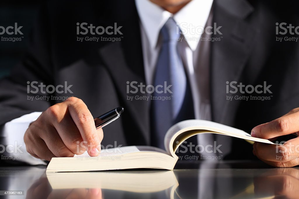 Businessman with Pen and Book stock photo