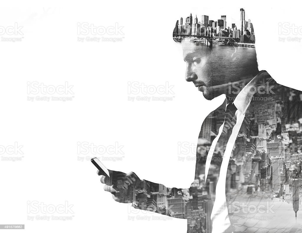 Businessman with phone double exposed with city images stock photo