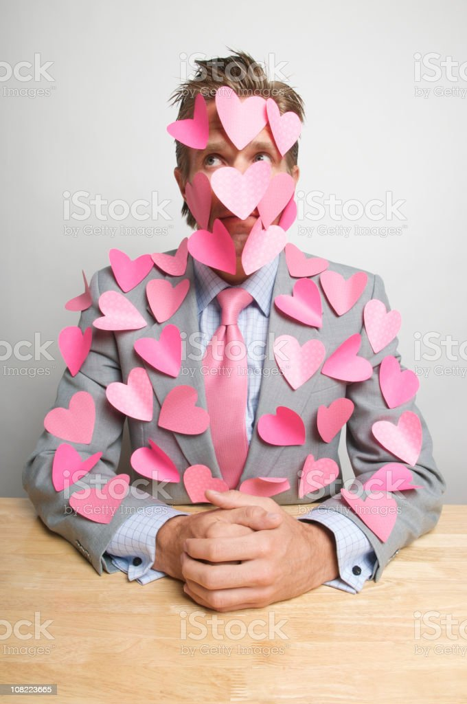 Businessman with Pink Hearts All Over Him royalty-free stock photo