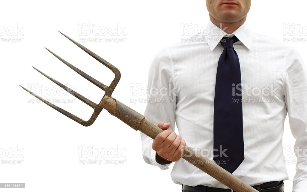 Businessman with pitchfork in hand on white background stock photo
