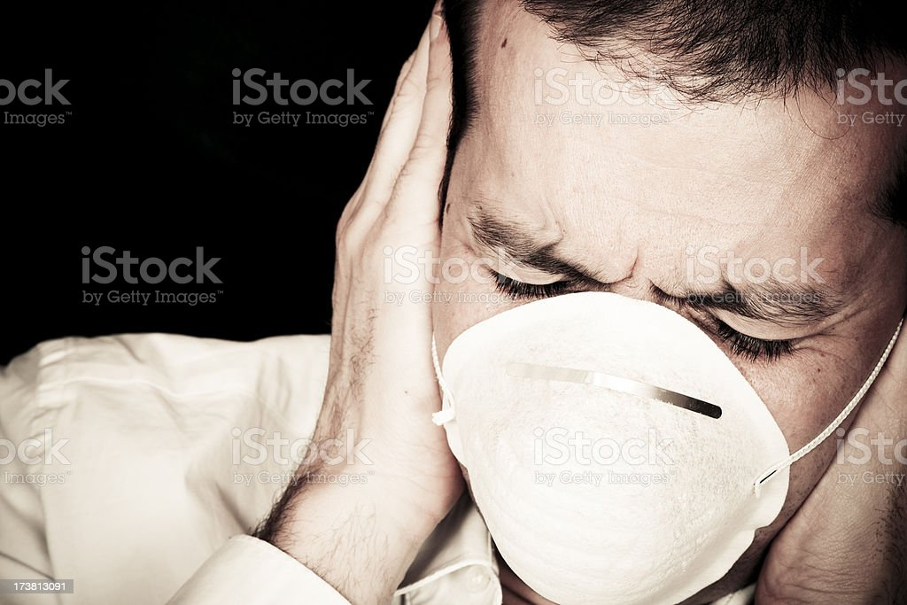 Businessman with protective mask royalty-free stock photo