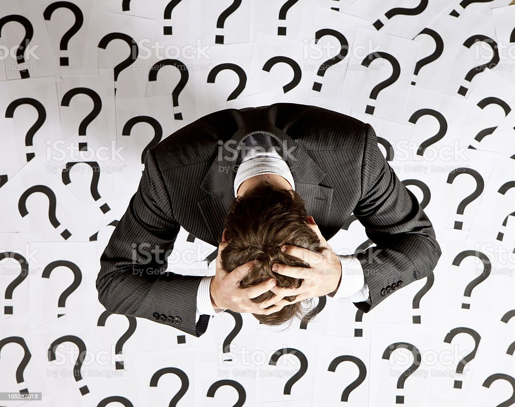 Businessman with question marks royalty-free stock photo