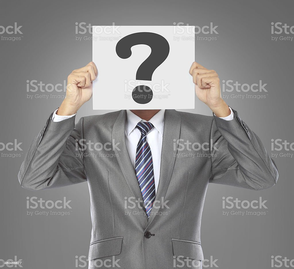 businessman with question mask stock photo