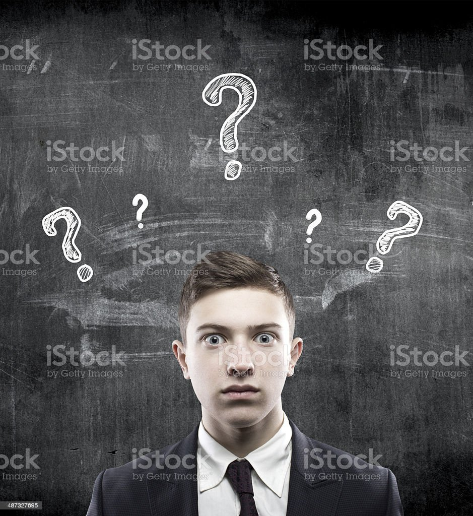businessman with questions stock photo
