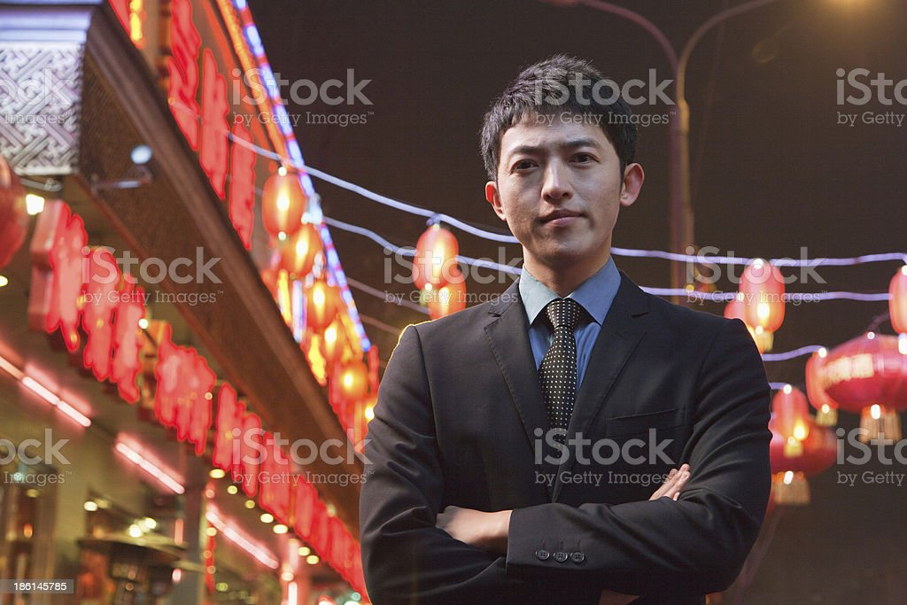 Businessman with red lanterns in the background royalty-free stock photo
