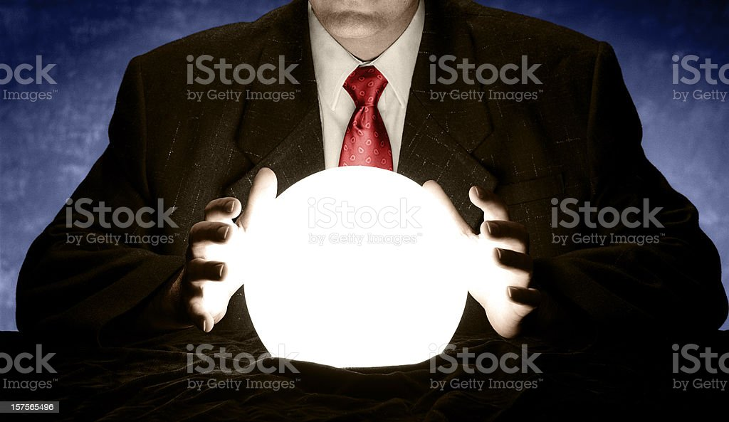 Businessman with Red Tie Consulting Glowing Crystal Ball stock photo