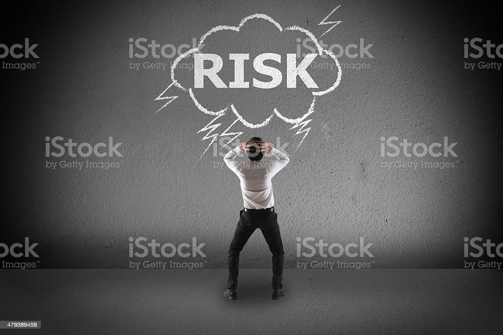 Businessman with risk word stock photo