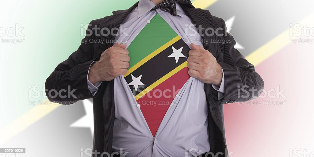 Businessman with Saint Kitts and Nevis flag t-shirt stock photo