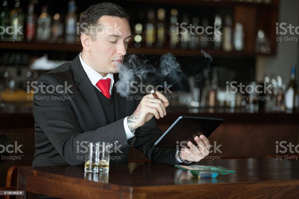 Businessman with scotch and cigar stock photo
