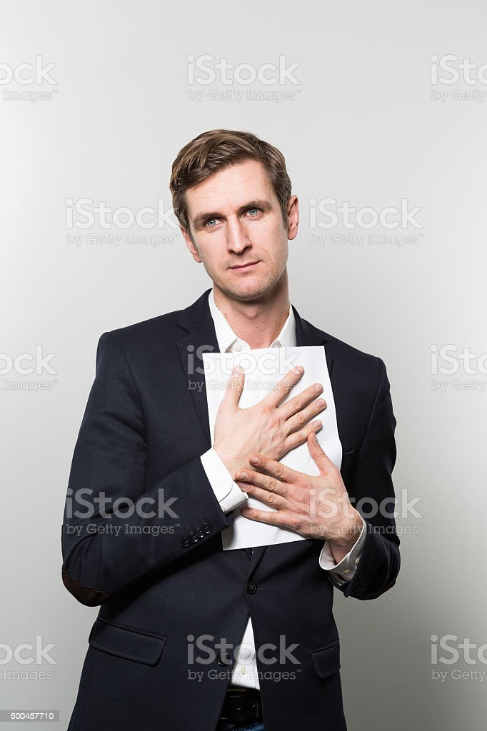 businessman with sheet of paper stock photo