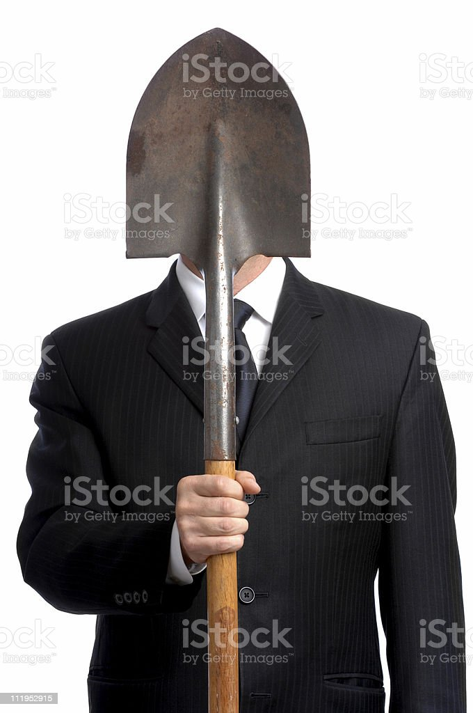 Businessman with Shovel Hiding Face Isolated on White Background stock photo