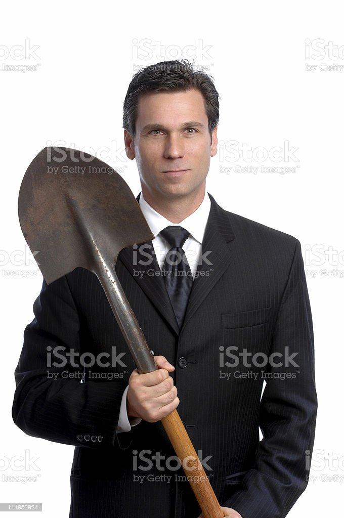 Businessman with Shovel Isolated on White Background stock photo