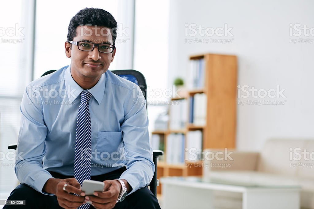 Businessman with smartphone stock photo