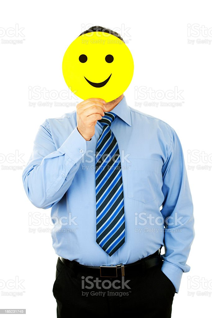 businessman with smile mask royalty-free stock photo