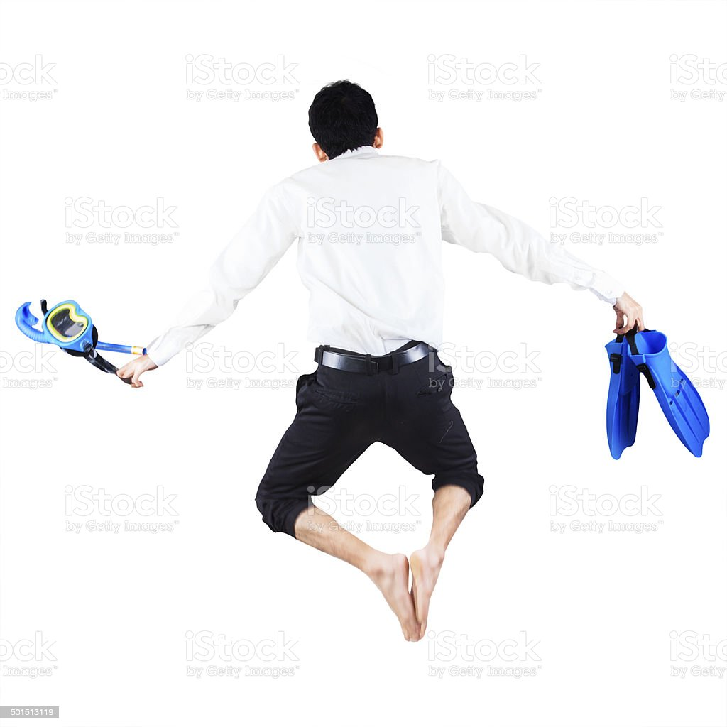 Businessman with snorkeling gear jumping stock photo
