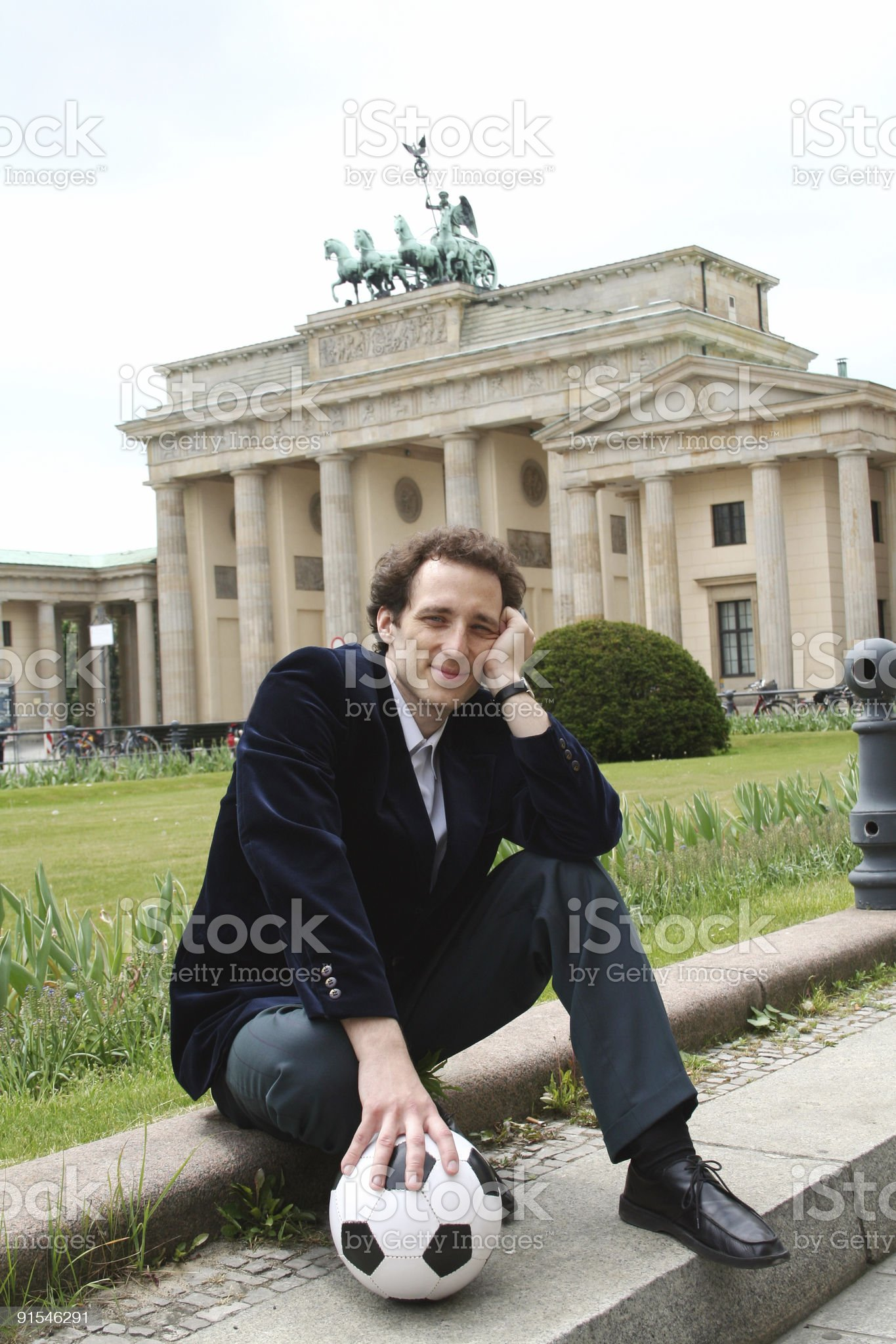 Businessman with soccer ball in Berlin royalty-free stock photo