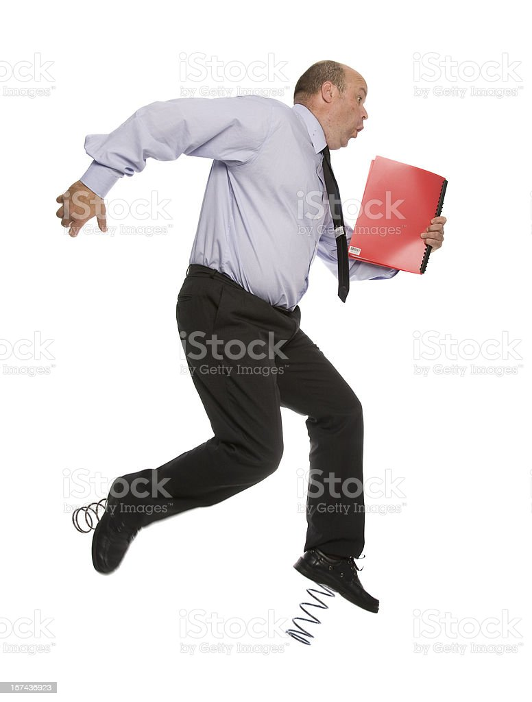 A businessman with springs on his feet royalty-free stock photo