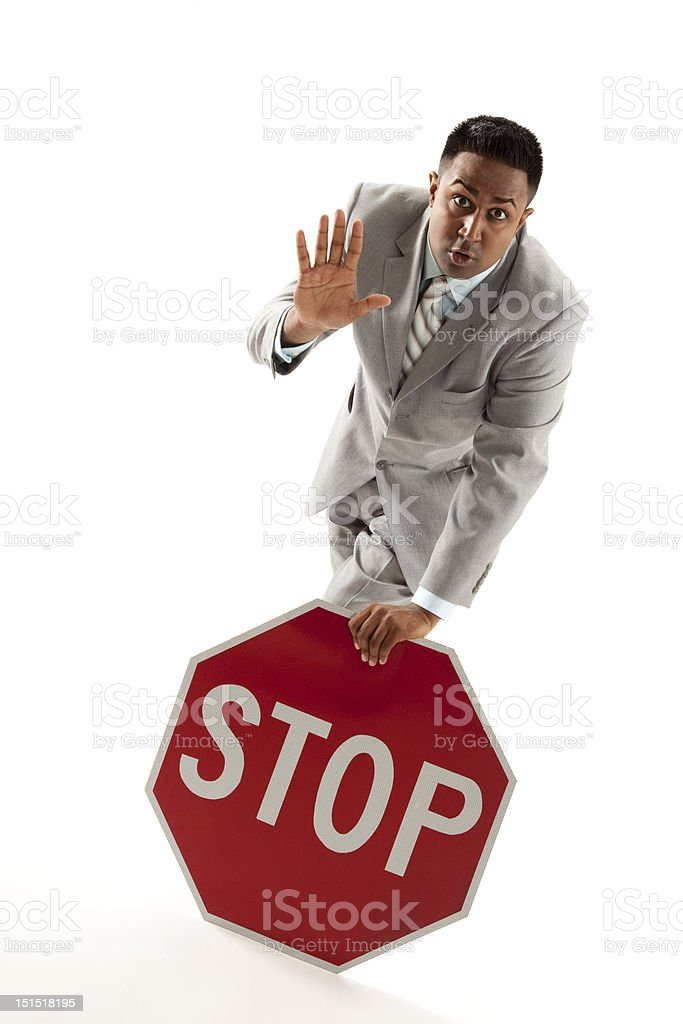 Businessman with stop sign stock photo