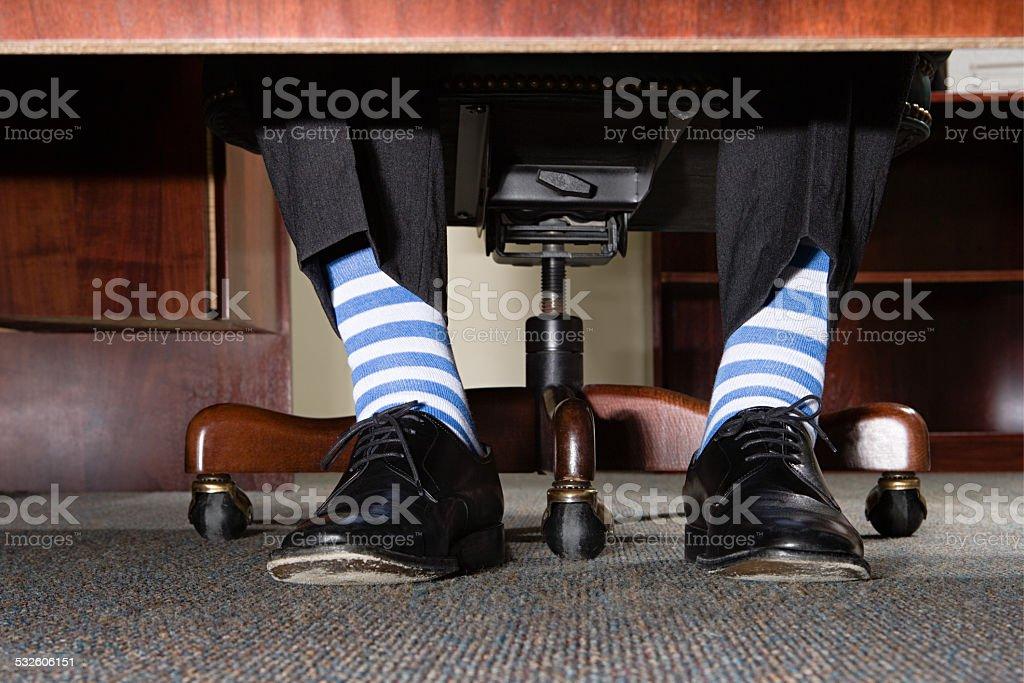 Businessman with striped socks stock photo