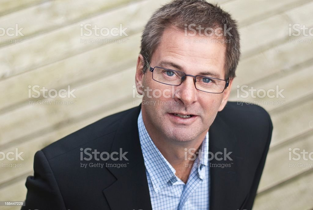 Businessman with strong presence stock photo