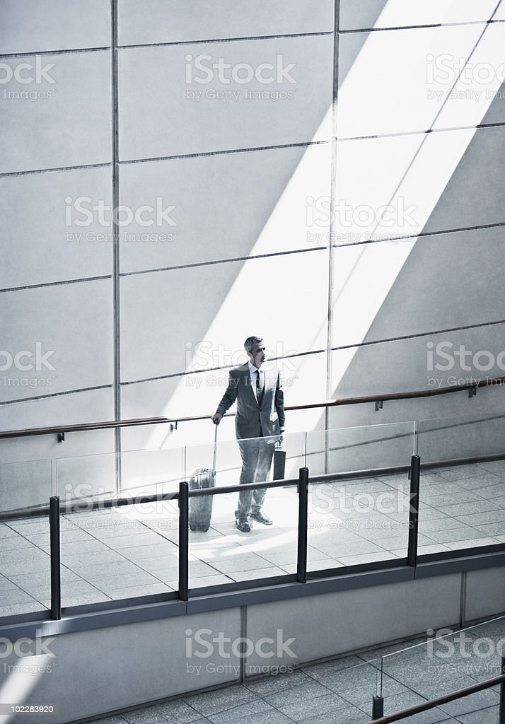 Businessman with suitcase on ramp royalty-free stock photo