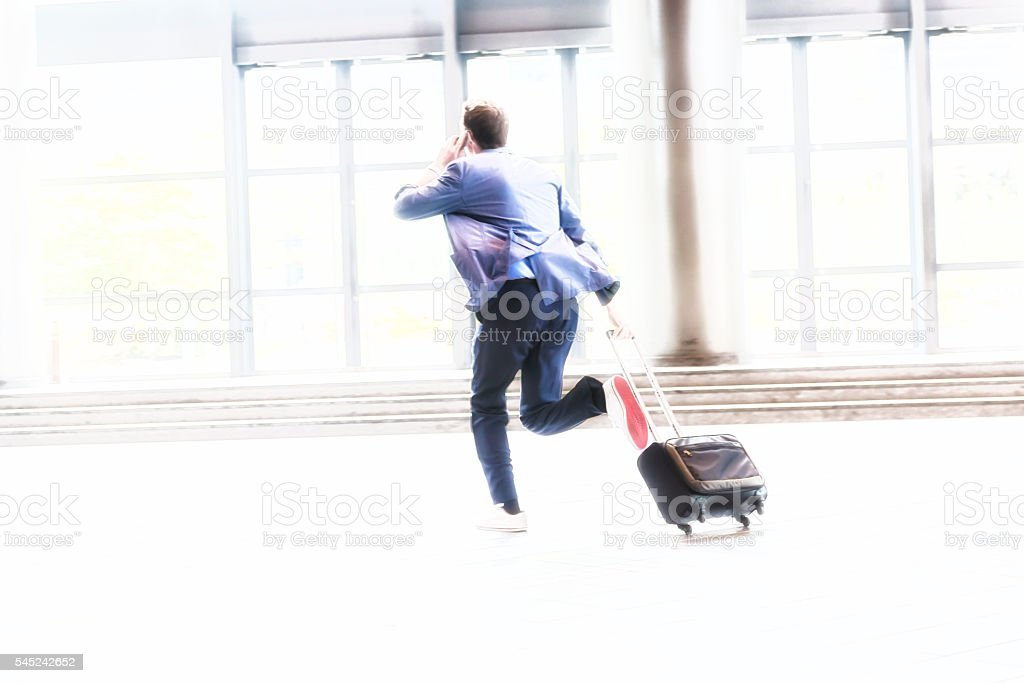 Businessman with Suitcase Running, Kyoto, Japan stock photo