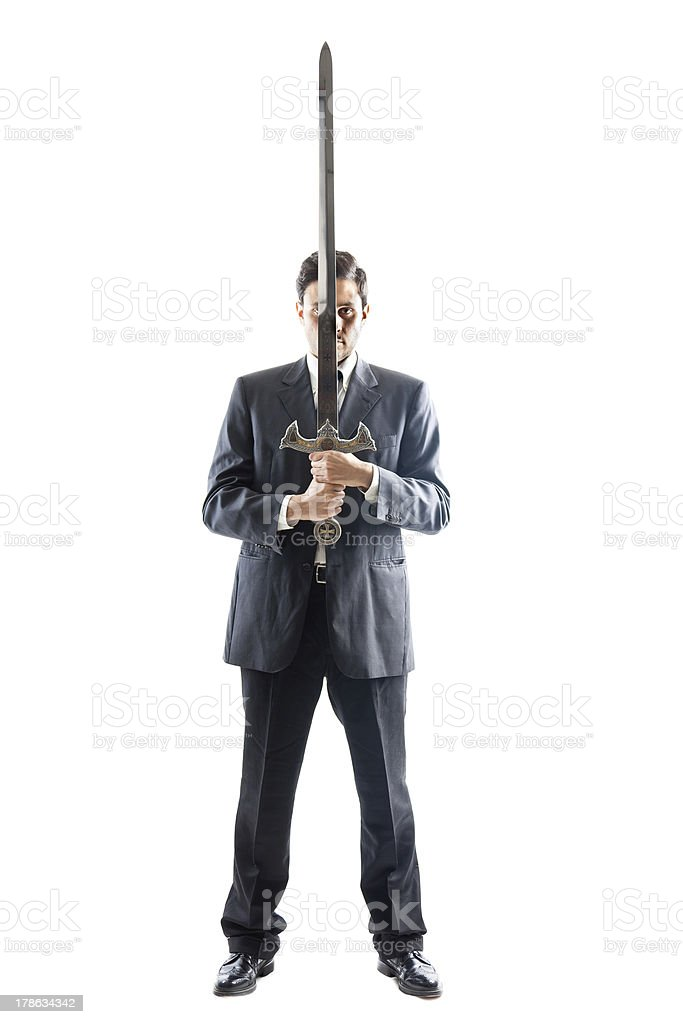 Businessman with sword royalty-free stock photo