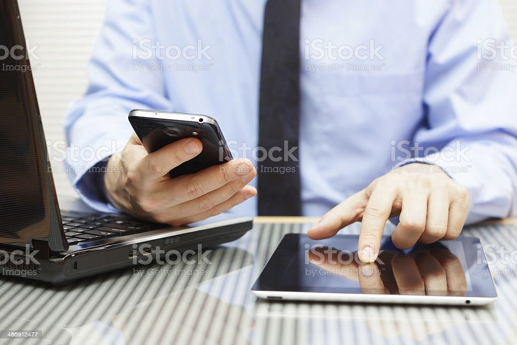 businessman is working on tablet and using smart phone stock photo