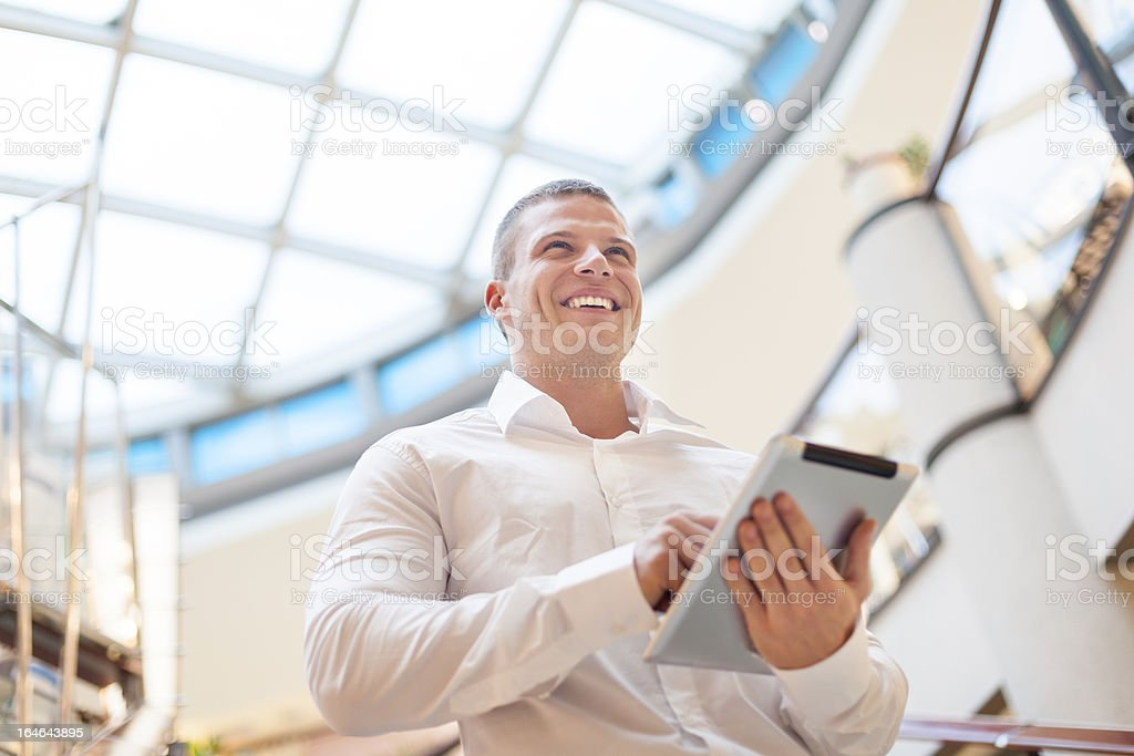 Businessman with tablet computer in modern building stock photo