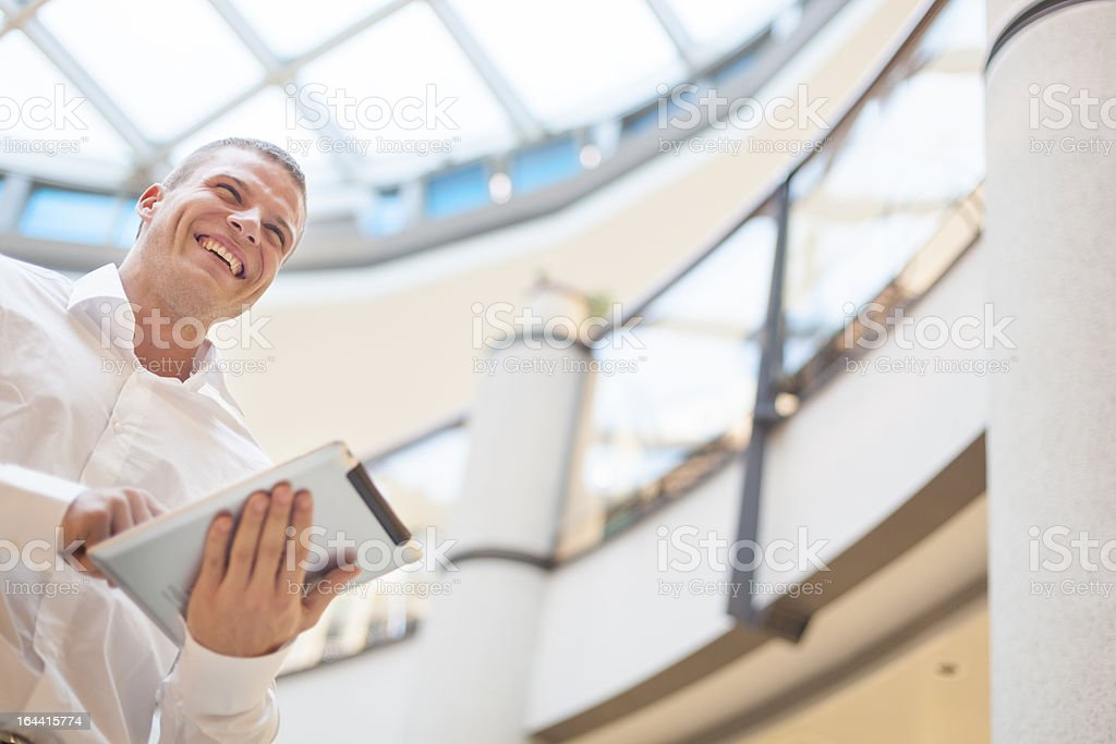 Businessman with tablet computer in modern business building stock photo