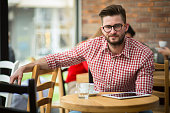 Businessman with tablet in cafe